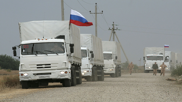 A Russian convoy of trucks carrying humanitarian aid for Ukraine are parked by the side of a road near Kamensk-Shakhtinsky, Rostov Region, September 12, 2014. REUTERS/Alexey Koverznev (RUSSIA - Tags: MILITARY SOCIETY POLITICS TRANSPORT CIVIL UNREST CONFLICT)