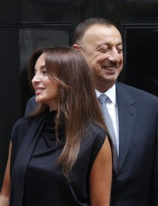 Azerbaijan President Ilham Aliyev, right, and his wife Mehriban Aliyeva, left, talk with British Prime Minister Gordon Brown and his wife Sarah Brown, not seen, outside Brown's official residence at 10 Downing Street, in central London, following their meeting, Monday July 13, 2009. (AP Photo/Lefteris Pitarakis)