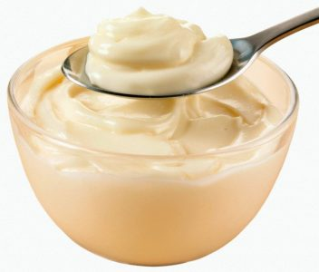 22 Apr 2008 --- Mayonnaise in a glass bowl and on a spoon --- Image by © Foodfolio/the food passionates/Corbis